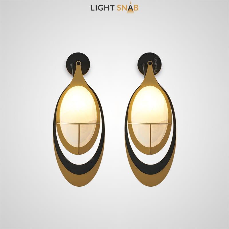 Настенный светильник Vigrid с овальным стеклянным плафоном в обрамлении металлических эллипсов