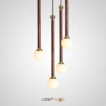Подвесной светильник Bast с латунным элементом на удлиненном деревянном корпусе и шарообразным матовым плафоном